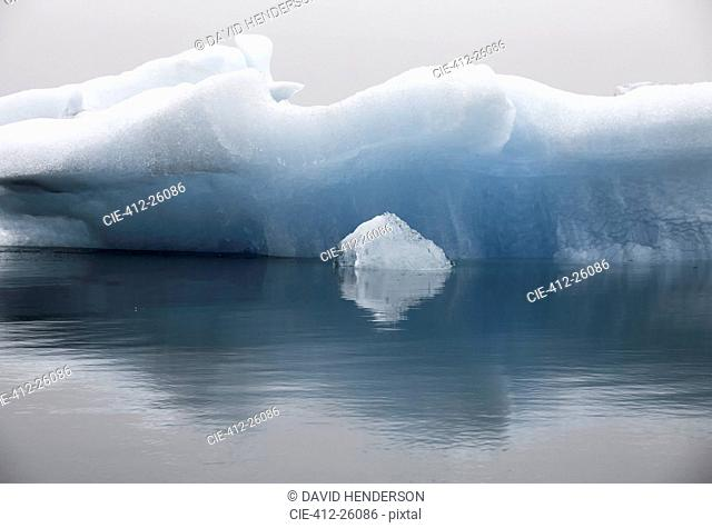 Blue iceberg formation in calm water, Jokulsarlon, Iceland