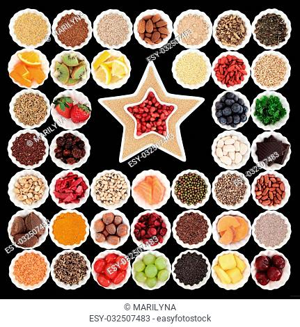 Large health and superfood collection in porcelain bowls with star shaped dishes over black background. High in vitamins and antioxidants