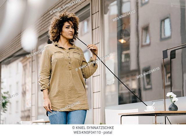 Woman drinking coffee with oversized straw