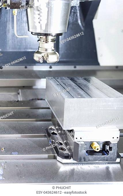 The face milling tool with the raw material work piece on the CNC milling machine