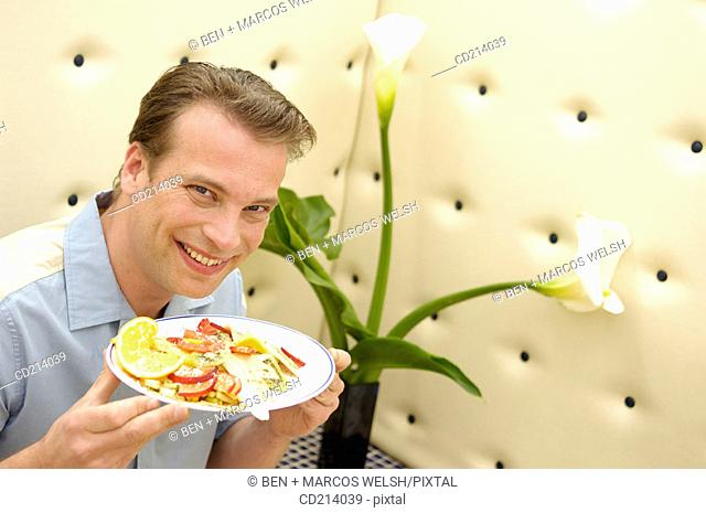 Man in bar having breakfast