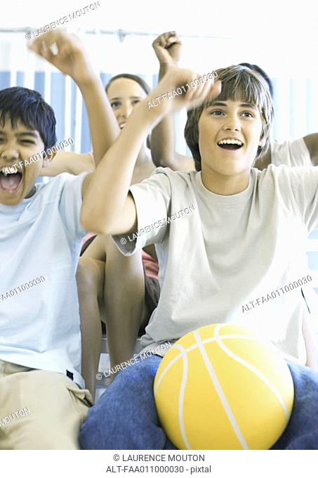 Young teens with basketball shouting