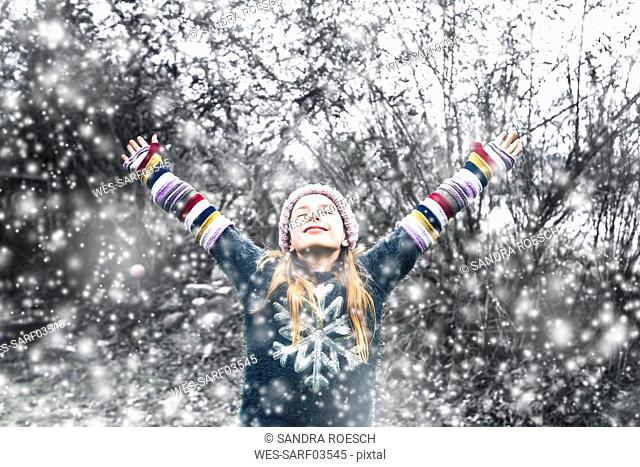 Happy girl at snowfall