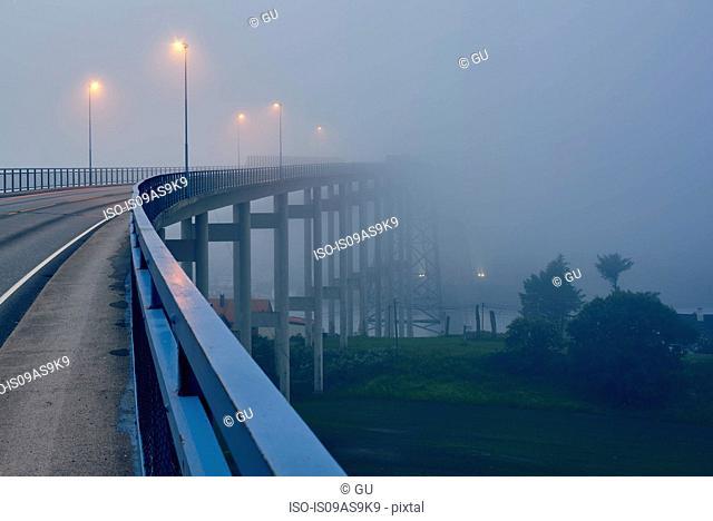 Misty empty elevated road illuminated by street lights, Haugesund, Rogaland County, Norway