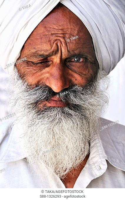 Old Sikh man in the Golden Temple complex, Punjab Amritsar India