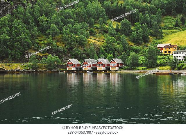 Red Wooden Docks In Town Of Flam, Western Side Of Norway Deep In Fjords. Forest And Water Background. Copy Space. Sognefjord Port
