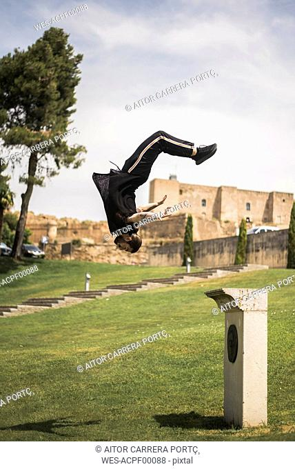 Young man doing parkour in a park