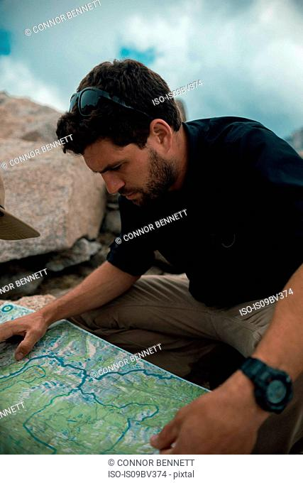 Hiker reading map, Mineral King, California, United States