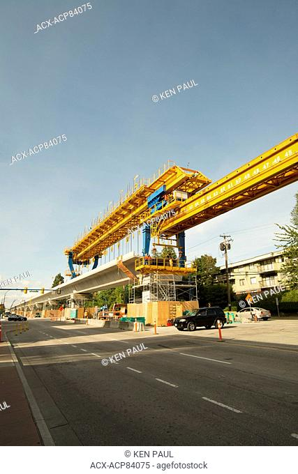 Elevated gantry crane during construction of the Skytrain Evergreen Line. Burnaby, British Columbia, Canada