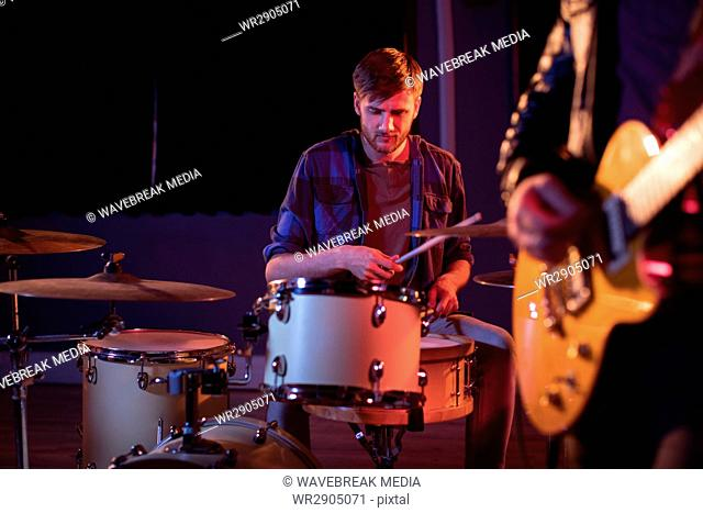 Drummer playing drums in studio