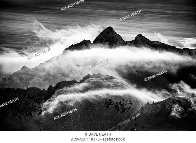 Mount Harlow with cloud veil in Black and white in the Valhalla Mountain range, BC, Canada, Winter