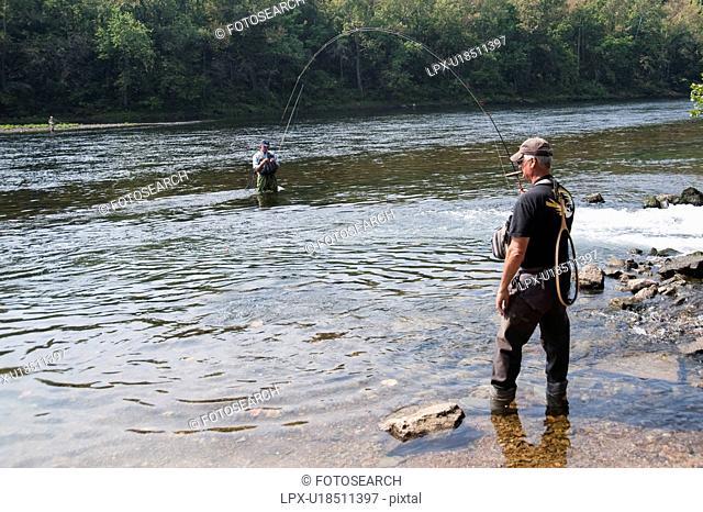 Fly fishing in lake Taneycomo in Branson, Missouri
