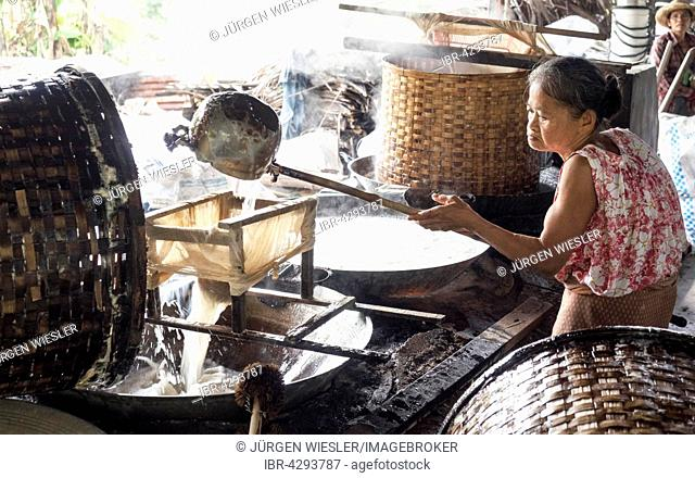 Coconut blossom syrup production, vaporisation, used as sweetener, Amphawa, Samut Songkhram Province, Thailand