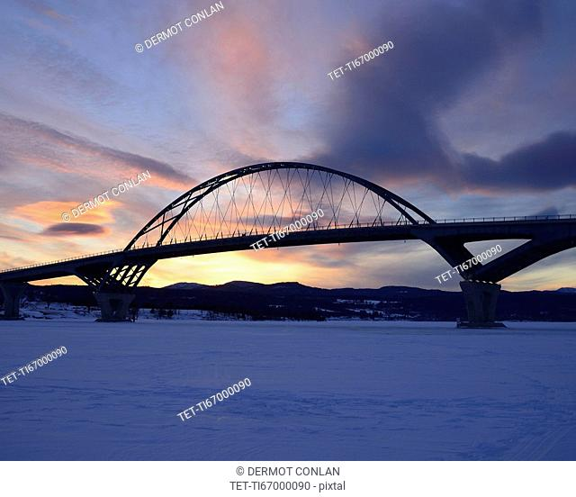 Lake Champlain Bridge linking New York and Vermont over a frozen Lake Champlain at Crown Point, snowed landscape at dusk