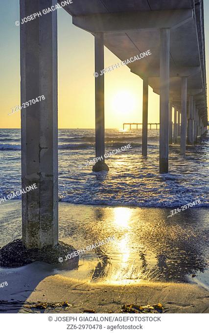 Coastal sunset and ocean view. Ocean Beach Pier, San Diego, California