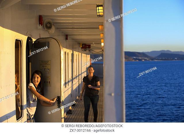 Tourists in the deck of Safari Endeavour cruise anchored in La Paz, Sea of Cortes, Baja California Sur, Mexico