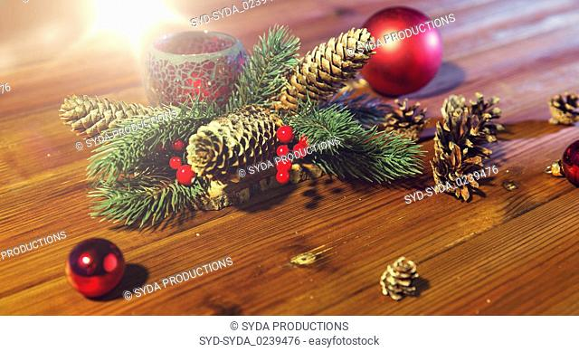 christmas fir branch decoration and candle lantern