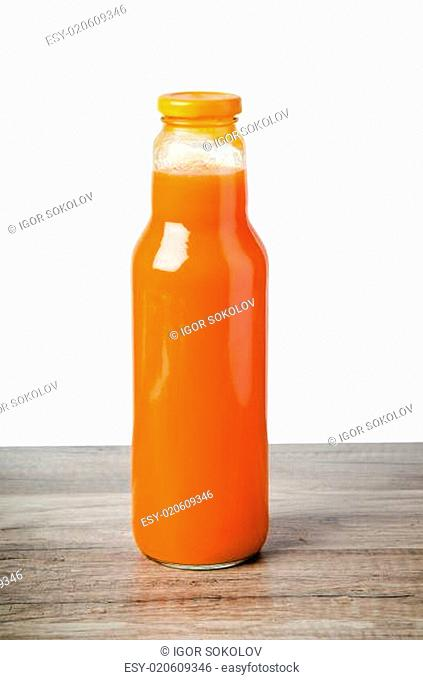 Bottle with carrots juice, it is isolated on white