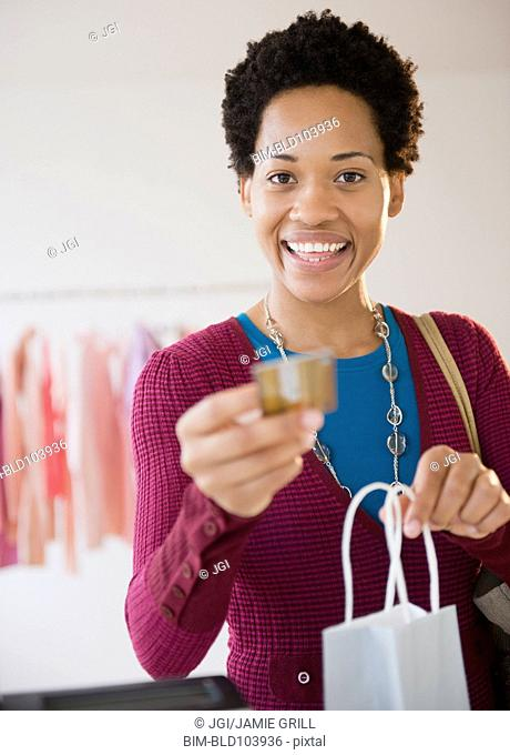 African American woman shopping with credit card