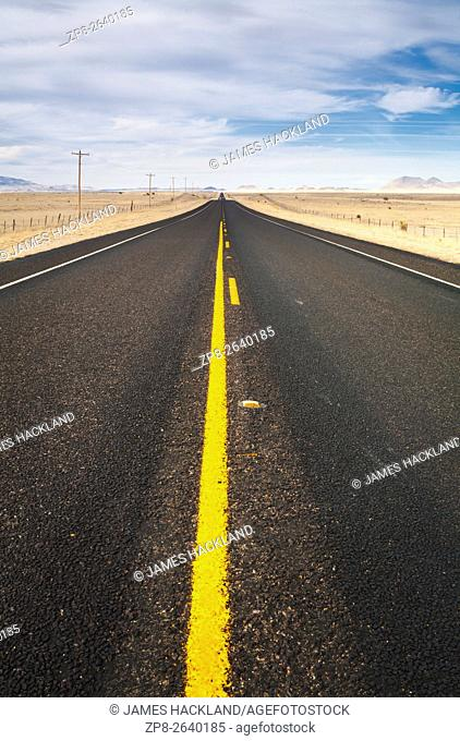 A deserted two-lane highway north of Marfa. State Highway 17, Presidio County, Texas, USA