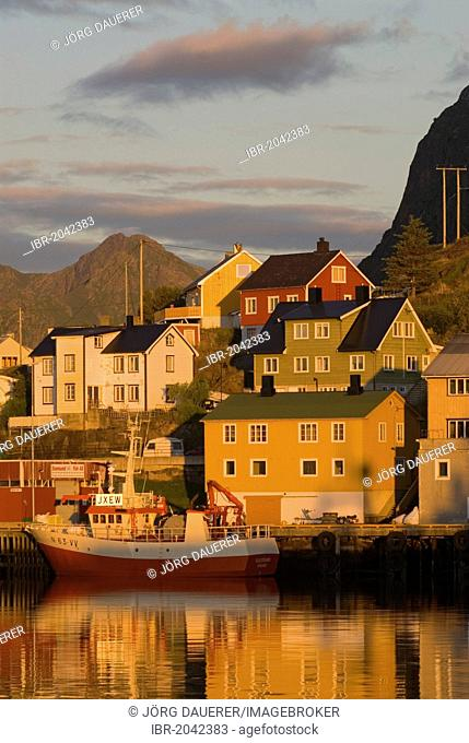 The boats and houses of Stamsund illuminated by warm morning light, Nordland, Norway, Europe