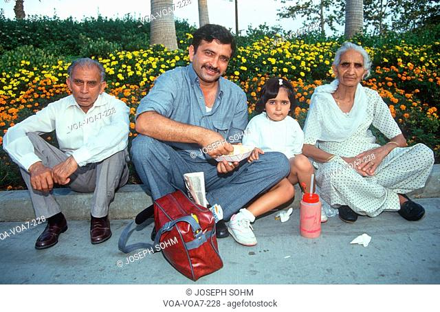 An Indian family in Pomona, CA sitting on the curb