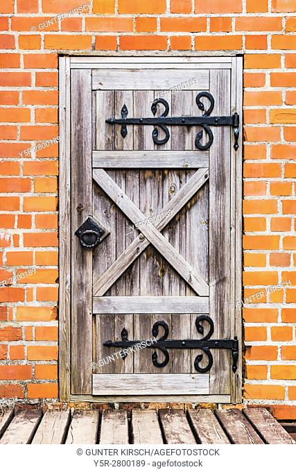 Old wooden door in Trakai Island Castle. The Castle was built in the 14th century and is situated close to Vilnius, Lithuania, Baltic States, Europe