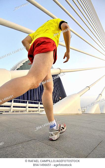Man running on Assut de l'Or bridge, City of Arts and Sciences by Santiago Calatrava, Valencia, Comunidad Valenciana, Spain