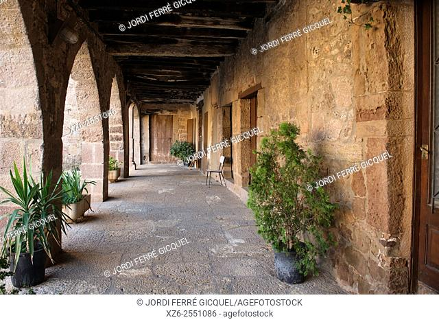 Arcaded square in the medieval town of Santa Pau, La Garrotxa, Catalonia, Spain, Europe