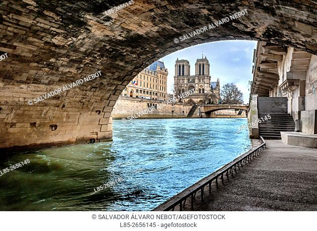 Notre Dame Cathedral view from under the bridge Saint Michel, River Seine and the Prefecture of Police, Paris, France
