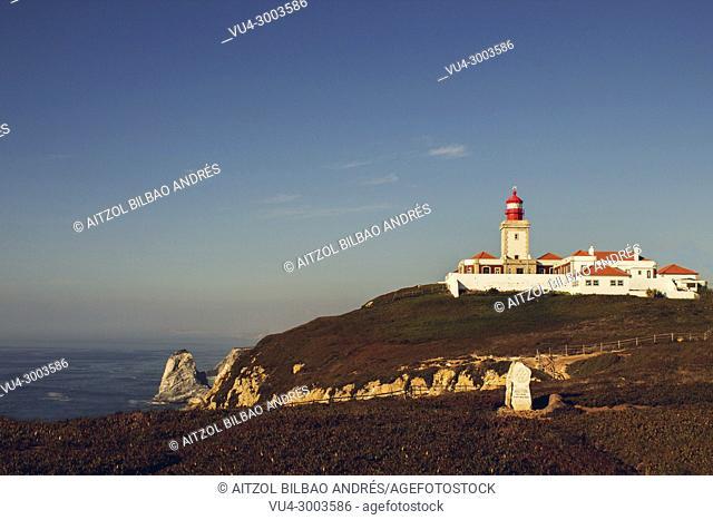 Cabo da Roca lighthouse, Sintra, Lisbon, Portugal. Sunny sunset in the atlantic sea