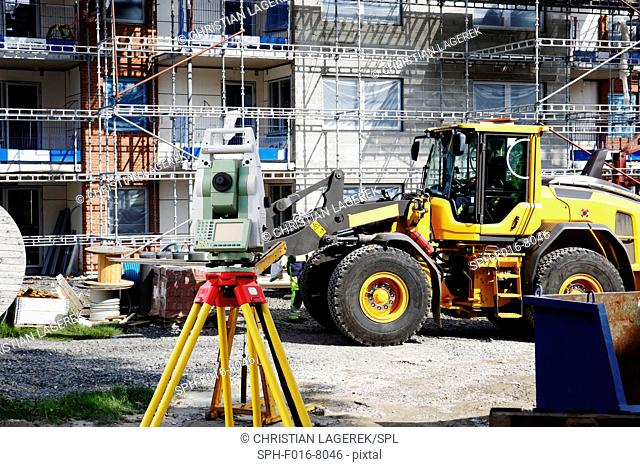 Construction site with theodolite in foreground