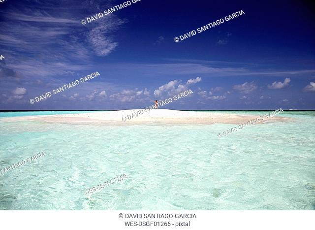 Maldives, Maafushi island, woman on sandbank in shallow water