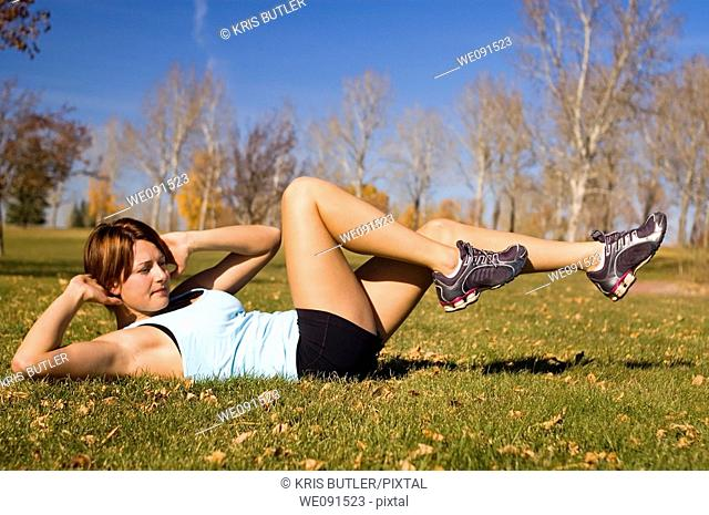 Young woman doing a bicycle ab exercise