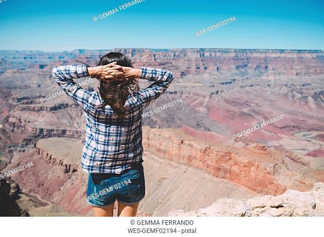 USA, Arizona, Grand Canyon National Park, Grand Canyon, back view of woman looking at view