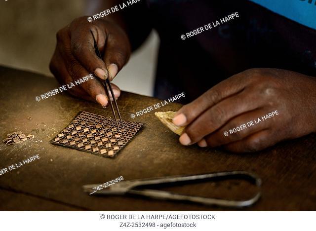 Silversmith creating silver jewellery. Ibo Island. Mozambique