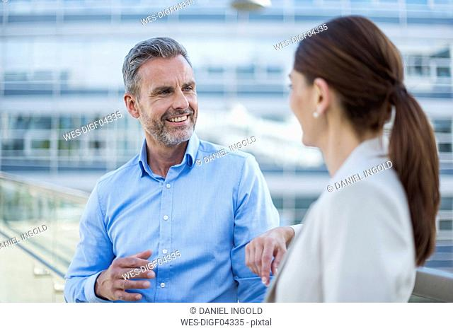 Portrait smiling businessman face to face to his business partner