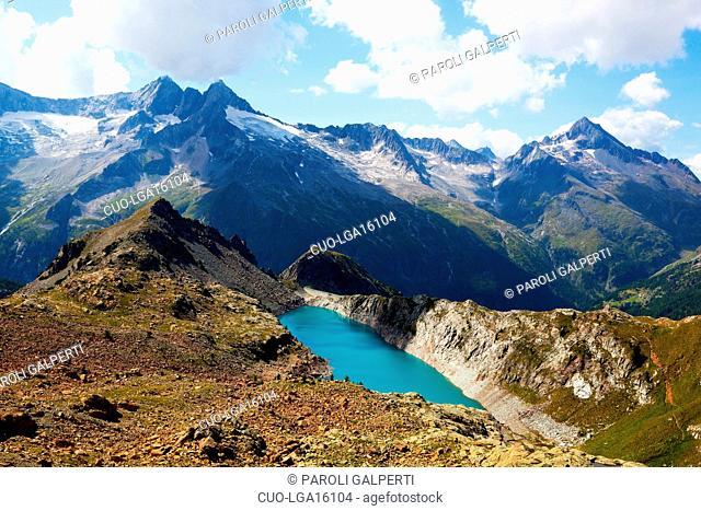 The Lake Pirola in Valmalenco, in the background Cima di Rosso, Cima di Vazzeda,Cima di Valbona, Monte del Forno and Muretto Pass; Valtellina, Lombardy, Italy