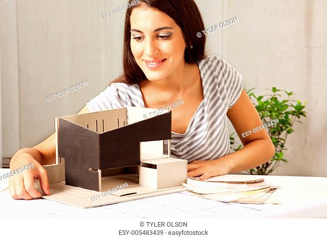 Architect with Blue Prints and Model