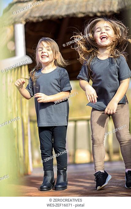 Two happy girls laughing and playing