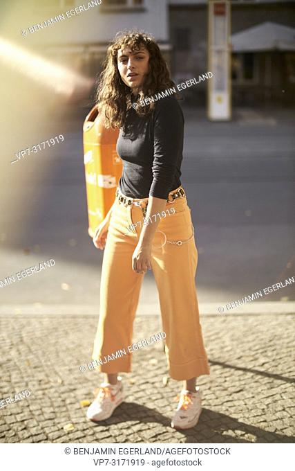 Woman in city, Berlin, Germany