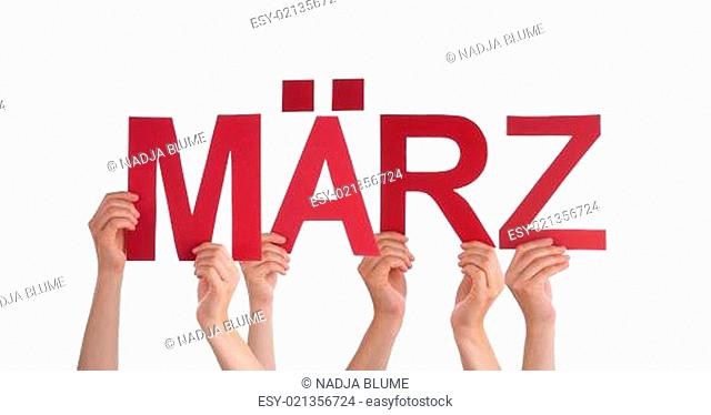Many Caucasian People And Hands Holding Red Straight Letters Or Characters Building The Isolated German Word Maerz Which Means March On White Background