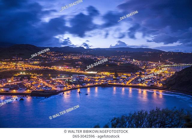 Portugal, Azores, Faial Island, Horta, elevated view town and Porto Pim from Monte da Guia, evening