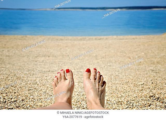 Woman sunbathing on beach, Island Pag, Croatia, Europe