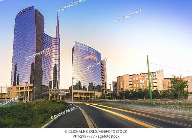Milan, Lombardy, Italy. Light trails in Porta Nuova district at dusk