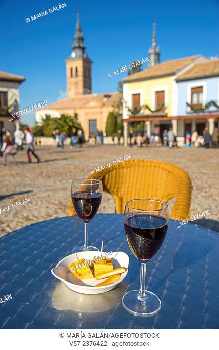 Two glasses of red wine with tapa of Spanish omelette in a terrace. Navalcarnero, Madrid province, Spain