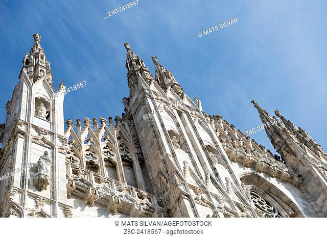 Duomo of Milan in a sunny day with blue sky in Lombardy, Italy