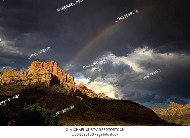 A rainbow appears during a thunderstorm at Zion National Park, Utah