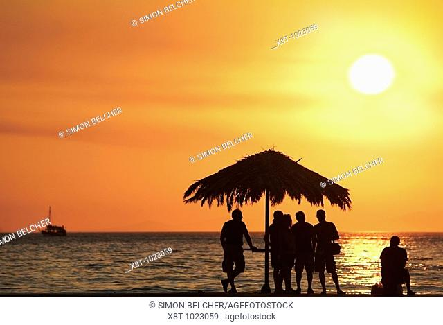 Tourists Watching the Sun Go Down Over the Adriatic Ocean