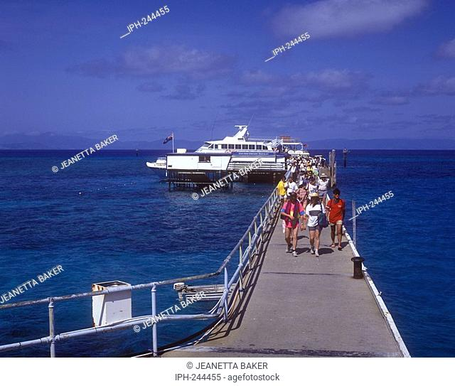 Tourists arriving to Green Island, a coral cay set within the Great Barrier Reef Marine Park near Cairns